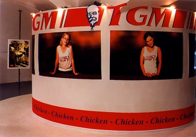 The first level – suggesting Czech identity in the '90s – is the central motif: TGM Chicken. It spoofs a ubiquitous fast-food chain and employs a caricature of the founding father of the nation, Tomáš Garrique Masaryk. (Caroline Wren, The Prague Post 6.-12. 10. 1999)