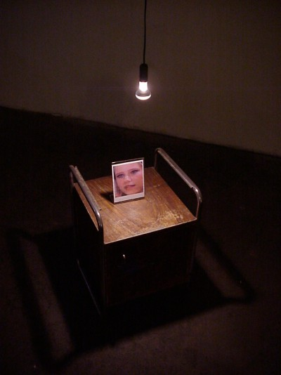Night table, detail; part of the video installation Pay Per View, 2001