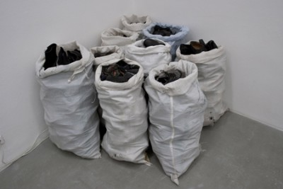 Untitled, large bags containing the number of shoes an average person uses during their lifetime, 2010